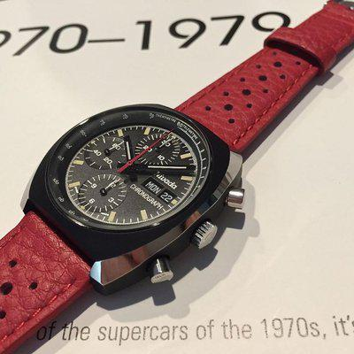 Red, blue, white or black textured rally bands+Heuer buckles